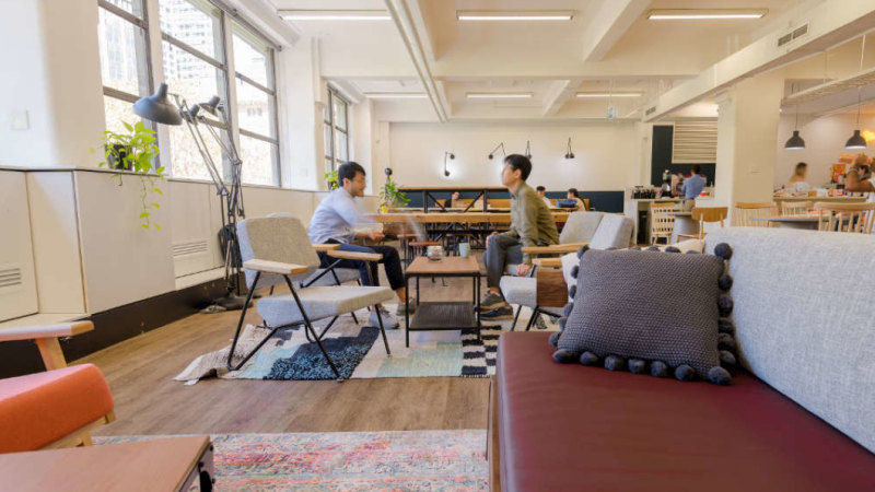 2 workers talking in an open space office design