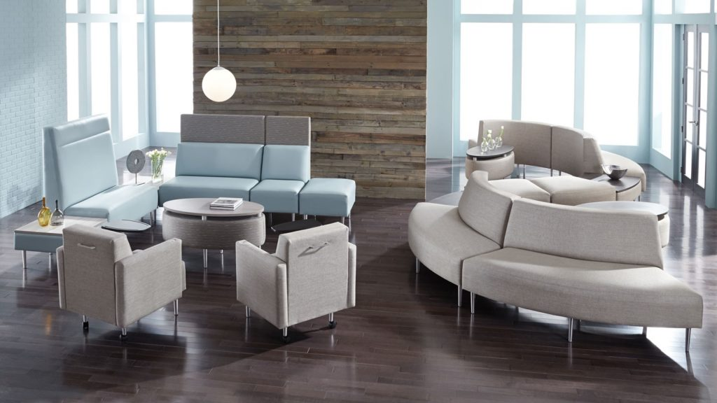 Lounge chair area with integrated privacy screens and plug and play charging modules for iPads and cell phones.