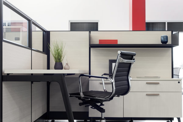 Single workstation cubicle with 67 high panels. Fabric is platinum and trim is dark tone.