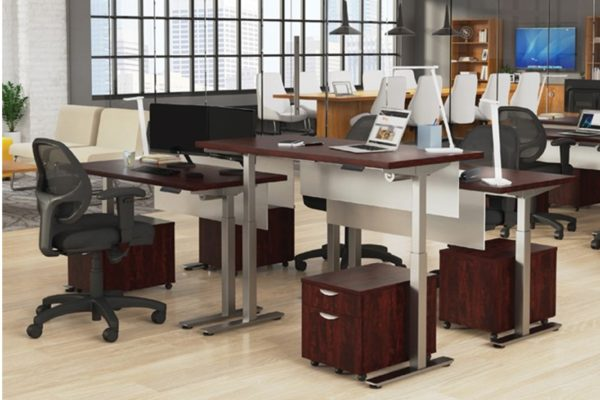 24x48 sit-stand desk grouping of 4 with tungsten powdercoat legs, mahogany laminate, frosted acrylic modesty maneels, and mobile box file pedestal filing.