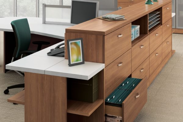 3-drawer lateral file bank of 4 units in medium cherry laminate including cubby hole storage and paper management slots.