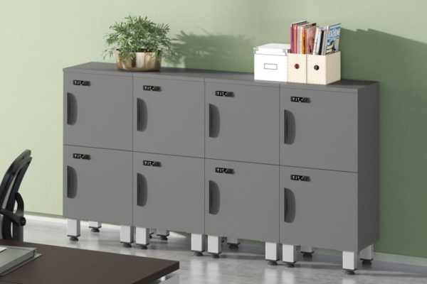Personal metal modular storage lockers in medium grey, stacked two high with legs for easy cleaning and maintenance.