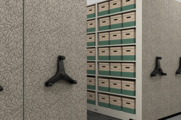 """High density mechanical assist mobile aisle filing units with fabric end cap accents, spaced shelving at 12"""" for easy banker box storage and accessibility."""