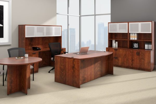 Office suite with desk, credenza, lateral file storage, conference table and hutch in medium cherry laminate.