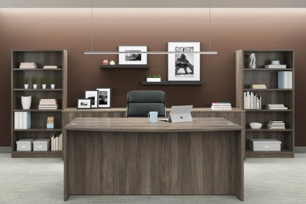 Executive desk with credenza and bookcases in natural walnut laminate.