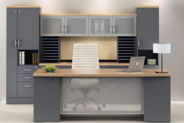 Desk and credenza in grey and maple with glass accents, storage towers, and paper management.