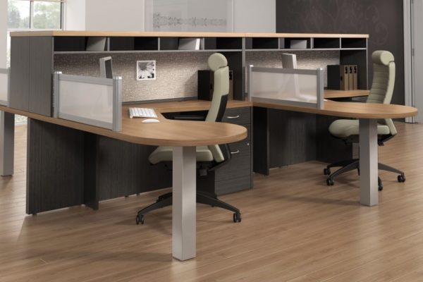 Team desking L-groups with low hutches in gray and natural cherry finishes.