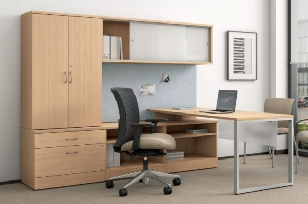 Wood veneer executive L-group in natural maple with silver accents and storage tower.