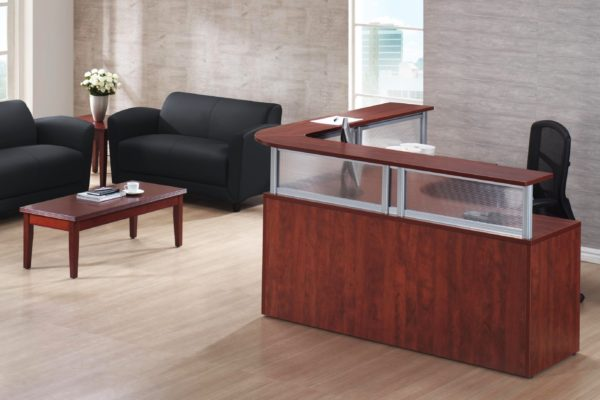Reception L-group in medium cherry laminate with silver post transaction counter and polystyrene privacy screens.
