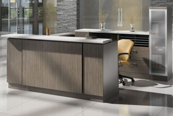 Reception desk U-group in Absolute Acajou laminate with white countertop accents and raised panel front modesty.