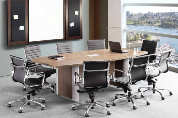Boat-shaped 48x96 conference table with elliptical aluminum trimmed bases and center power module, finished in modern walnut laminate.