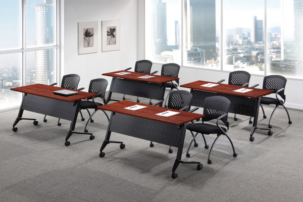 24x48 flip top training tables in classroom layout with black bases, casters, perforated modesty panels with cable management, and medium cherry laminate tops.