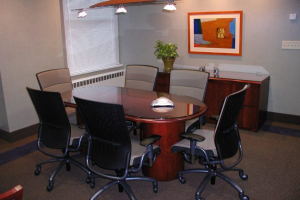 36x72 cherry veneer wood executive racetrack conference table with matching half drum bases, traditional table edge profile, and custom cut glass top for scratch and wear protection.