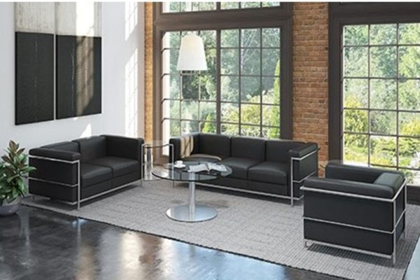 Le Corbusier waiting room furniture including sofa, loveseat, club chair in black Leathertek synthetics with chrome plating tubular frames.
