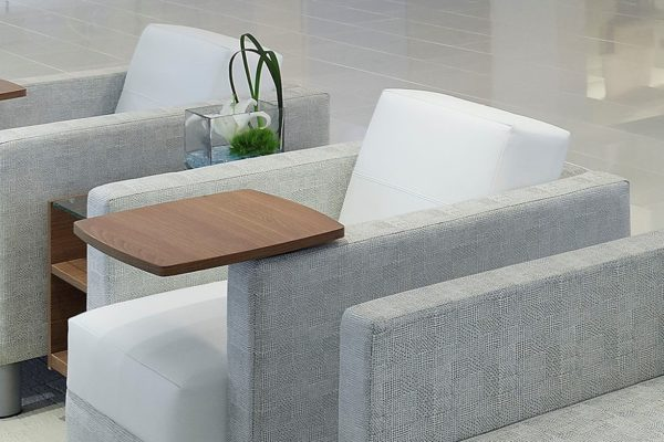 Medium walnut laminate tablet lounge chair in dual fabrics including white and light grey herringbone.