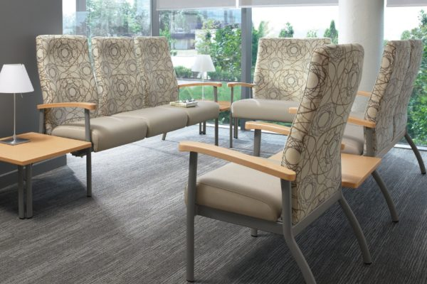 High back ganged healthcare seating group with tungsten frames and legs, designer-specified fabric, maple arm caps, and matching maple end tables.