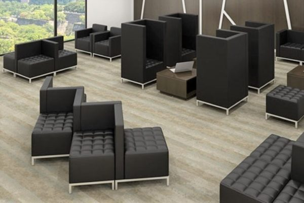 Square modular black open plan waiting room seating ensembles with black simulated leather, tufted seats, individual privacy height wraps, and nickel legs.