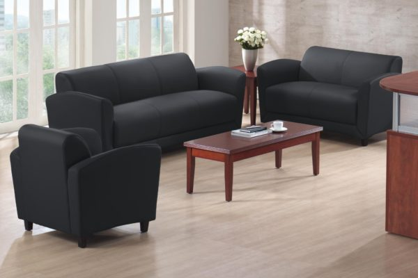 Contoured and curved reception grouping in black including club chair, sofa, and loveseat, all with mahogany feet. Also included is a matching 24x48 mahogany coffee table.